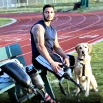 Gabe and his assistance dog, Wonka, Assistance (or service) dogs, unlike military working dogs, help military personnel in their civilian lives.