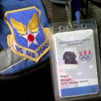 """Nepal is an assistance dog; this is his ID and part of his """"uniform"""". Assistance (or service) dogs, unlike military working dogs, help military personnel in their civilian lives. Courtesy Canine Companions for Independence (cci.org)."""